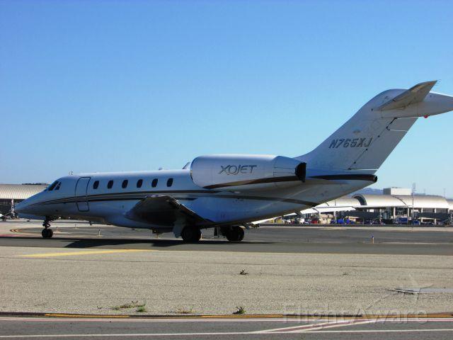 Cessna Citation X (N765XJ) - Holding short RWY 20R