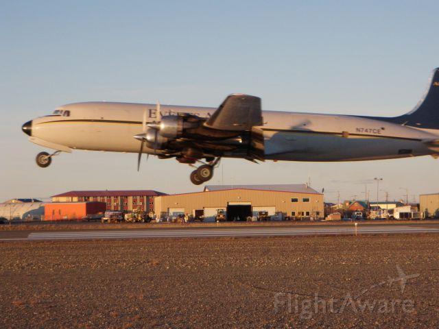 "Douglas DC-6 (N747CE) - ""Kotzebue Radio, Everts 747 Charlie Echo is airborne. Please activate flight plan."" (Everts Air Fuel departing runway 27, Kotzebue Alaska on 10.07.2010"