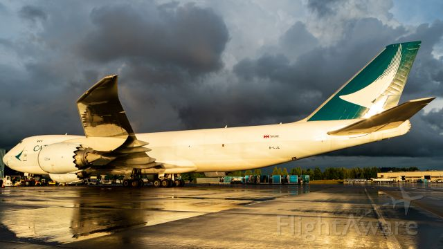 BOEING 747-8 (B-LJL) - Heavy rain and thunder storms in the distance. Fresh rain on the ground during golden hour? Perfection.