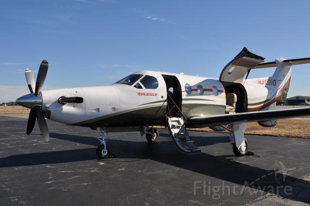 Pilatus PC-12 (N315NG) - PC-12 with main cabin door and cargo door open