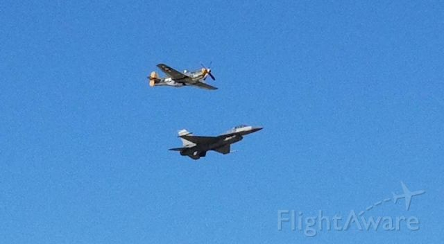 — — - Flyby of a P51 Mustang and F16