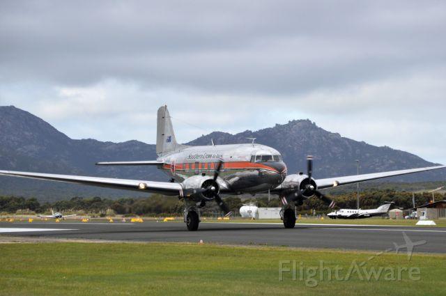 Douglas DC-3 (VH-TMQ) - Aero Logistics operating as Southern Cross Air Tours DC3 departing RWY23 at Flinders Island, 18 April 2021