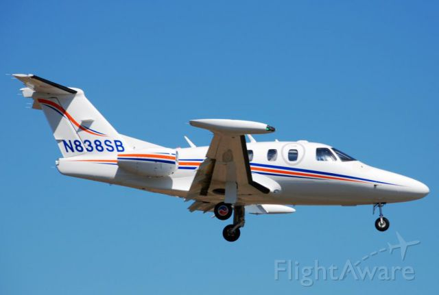 Eclipse 500 (N838SB) - Landing short final, runway 15 Toronto Buttonville Airport.