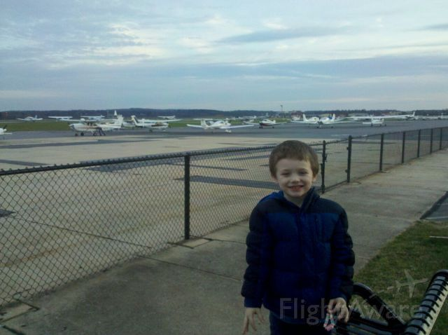 — — - My son posing for a picture with the various GA aircraft at Frederick Municipal Airport (KFDK).