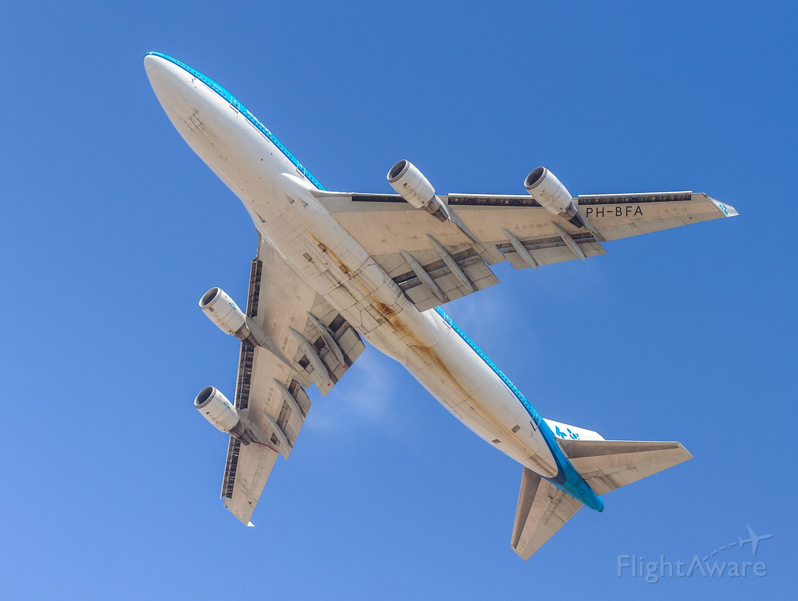 Boeing 747-400 (PH-BFA) - KLM blasts off runway 24L and directly overhead as we stand on Dockweiler Beach...