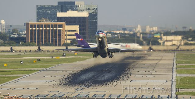 McDonnell Douglas MD-80 — - An American maddog blasts off from 31L while the FedEx next up for departure taxis into positionbr /9/12/17