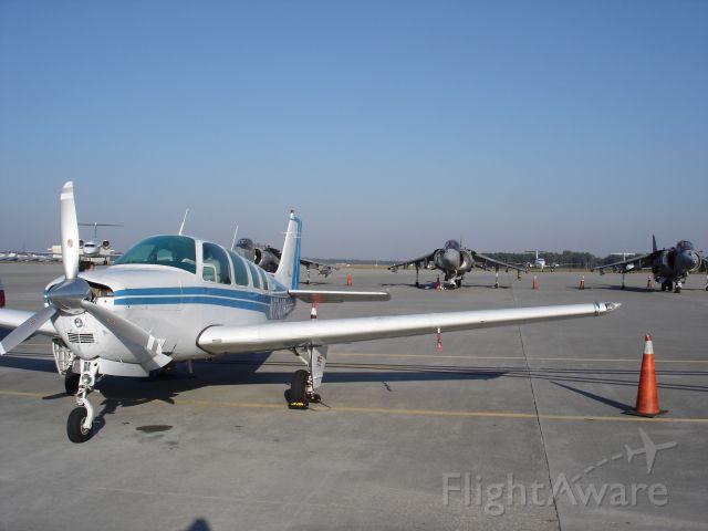 Beechcraft Bonanza (36) (N7747R) - Songbird among Hawks!