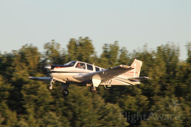 Beechcraft Bonanza (36) (N187J) - Just after rotating off runway 2