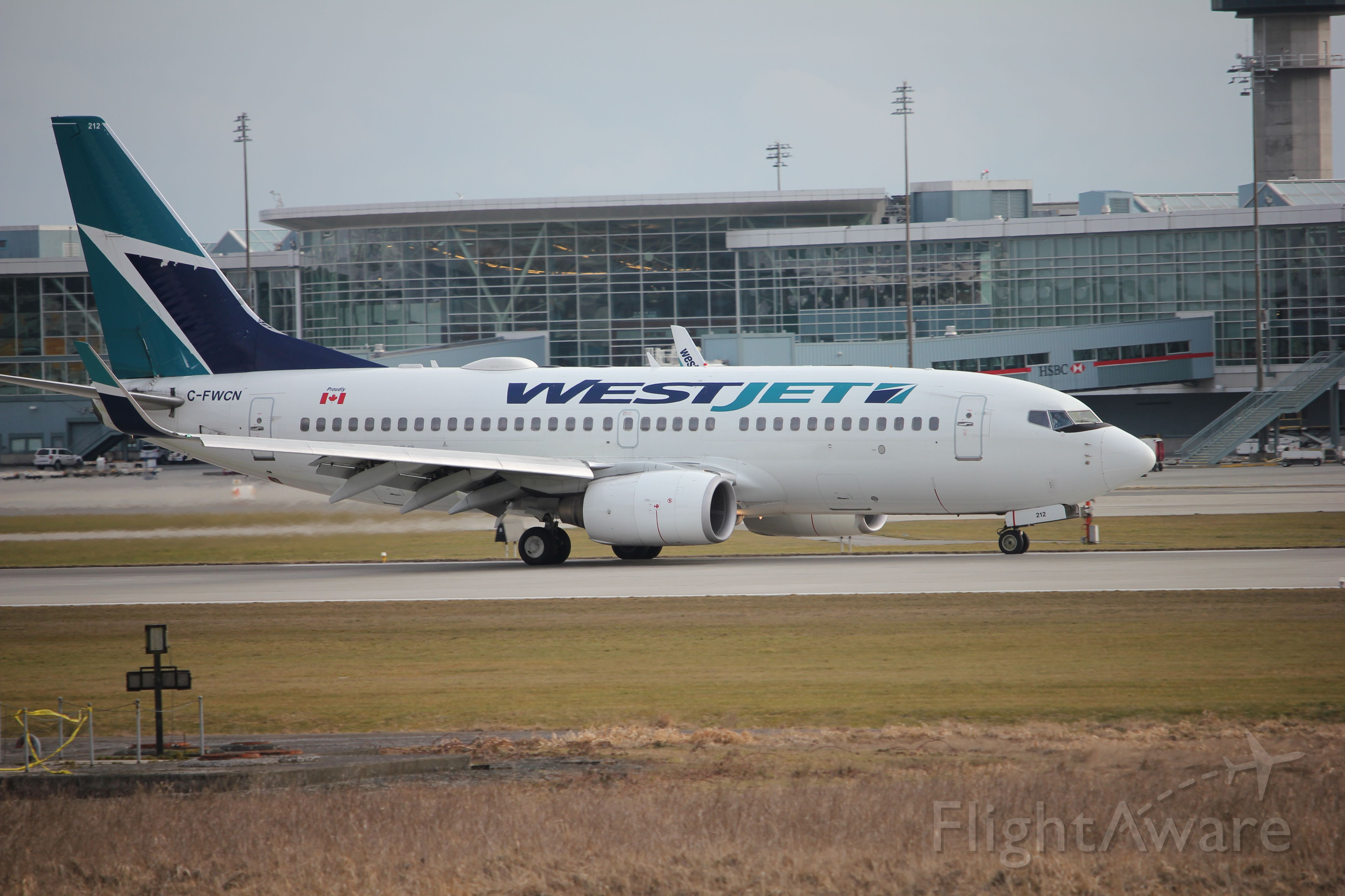 Boeing 737-700 (C-FWCN) - Spotting by 26R/08L. WestJet coming to a stop