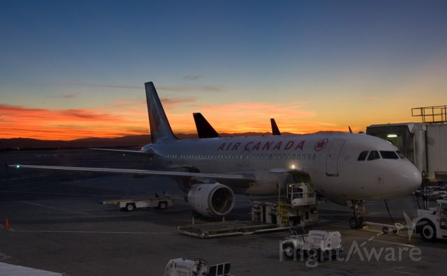 Airbus A320 (C-FDQV) - Sunrise at San Francisco airport, waiting to board.
