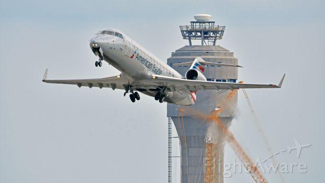 Canadair Regional Jet CRJ-200 (N250PS) - PSA Airlines (American Eagle) Bombardier CRJ-200 (N250PS) departs KCLT Rwy 36C on 03/30/2018 at 4:25 pm