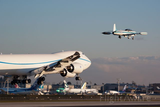 Boeing 747-200 (N747EX) - First landing. Note T-33 chase plane on right wing