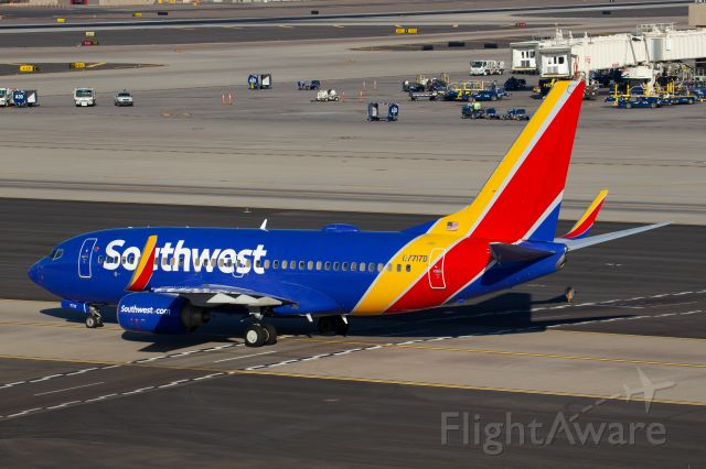 Boeing 737-700 (N7717D) - Spotted from Terminal 3 parking garage, level 8, at KPHX on November 14, 2020