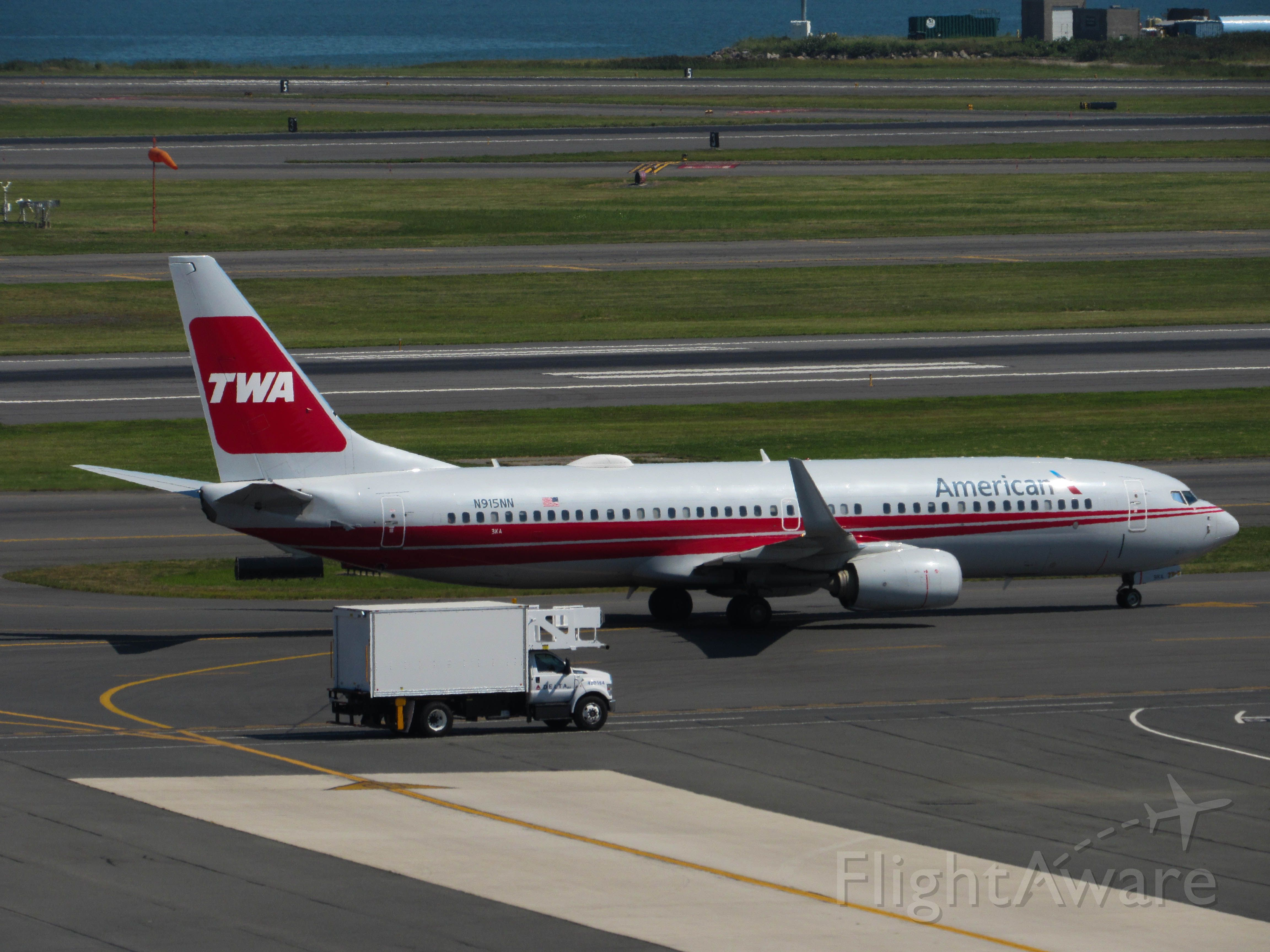 Boeing 737-800 (N915NN) - Americans TWA Heritage livery Taxies by the old American terminal at logan airport.