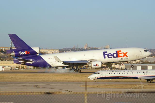 Boeing MD-11 (N573FE) - 12R arrival