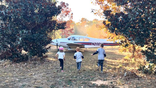 Piper Aztec (N20DM) - First Contact. This was the first time that the kids saw the Aztec in person in November 2016. After engine shutdown, they came galloping through the magnolias to check out this beauty!  Photo Credit: Shelley Romey
