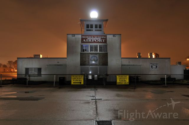"""— — - Frederick Airport.  30 miles north of Washington, DC.  Home of the AOPA.  Shot at midnight on 5/9/2009 with fog & rain adding to the spooky effect.      <a href=""""http://discussions.flightaware.com/profile.php?mode=viewprofile&u=269247"""">  [ concord977 profile ]</a>"""