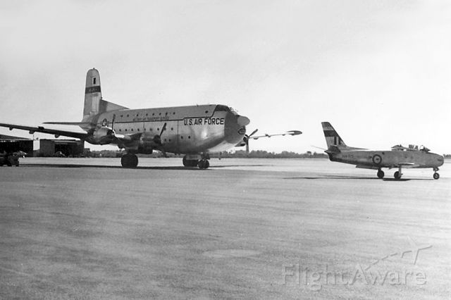 """North American F-86 Sabre (A94925) - CAC Sabre A94-925 passing USAF Douglas C-124A later converted to a """"C"""" Globemaster II 51-0151 East Sale (YMES)"""