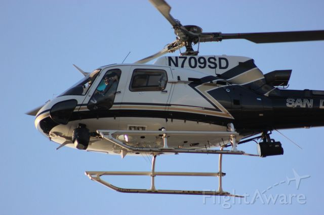 Eurocopter AS-350 AStar (N709SD) - N709SD, an SDPD Eurocopter AS-350 AStar is captured in all her glory departing the ABLE helipad on 09 SEP 2017 @ approx 1819PST. Seen from Kearny Villa Road at the SW corner of MYF. A big thanks to SDPD for their aerial support!