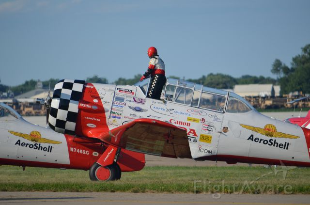 North American T-6 Texan — - EAA 2011 Aeroshell team member on climb out. Get it? On climb out... OK give me a break, its 2300 hours, this is the last of 41 pictures downloaded and I really should be sleeping since I work tomorrow. Seriously, thanks for looking at my pictures!