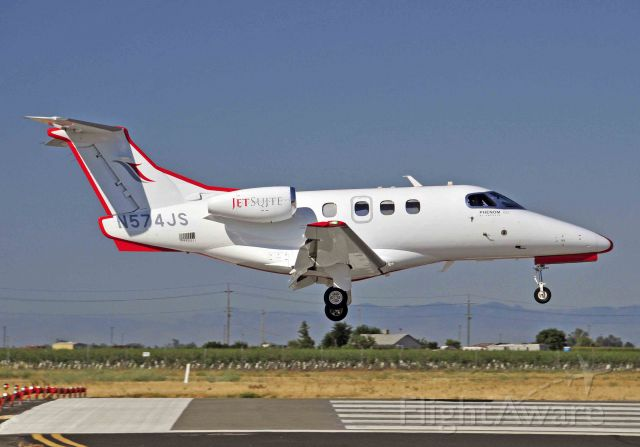 "Embraer Phenom 100 (N574JS) - ""Red Strip 163"" landing runway three-zero, Merced Regional Airport"
