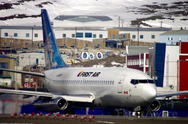 Boeing 737-200 (C-GCPT) - Beautiful day in Iqaluit, Nunavut. The big building in the background with all the Artwork is the Qikiqtani General Hospital. I wanted to show a different perspective of the Airport with the City in the background. Hope you like it?