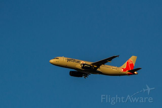 Airbus A320 (N605JB) - Jet Blue in Red Sox livery departing Long Beach airport on 11-1-2013