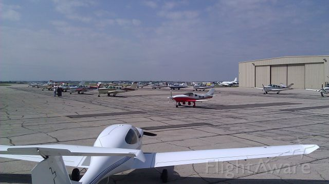 — — - Busy day at Advanced Aviation in New Century