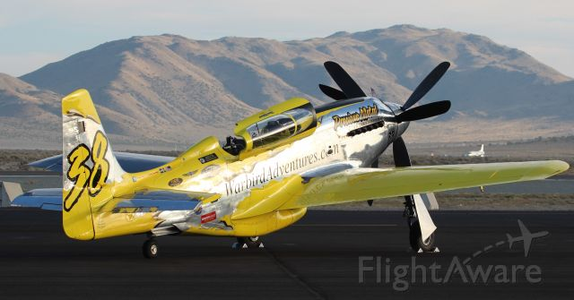 """North American P-51 Mustang (N6WJ) - Precious Metal looks out over """"The Valley of Speed""""."""