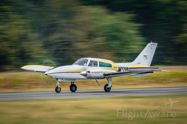 Cessna 310 (N511MB) - N511MB taking off from runway 24 at KLOM