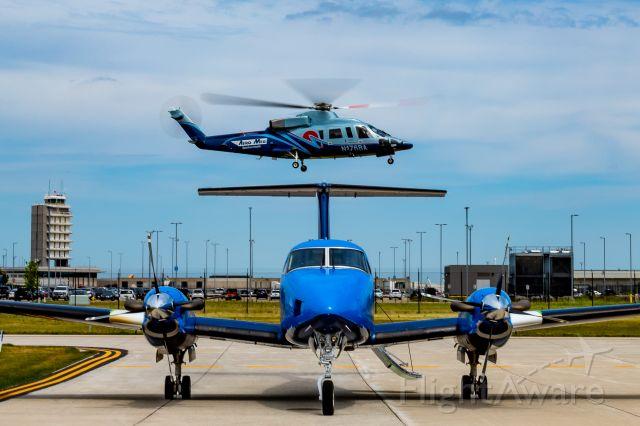 Sikorsky S-76 (N176BA) - AeroMed 2 landing at the AeroMed ramp with AeroMed 4 (N610TA)