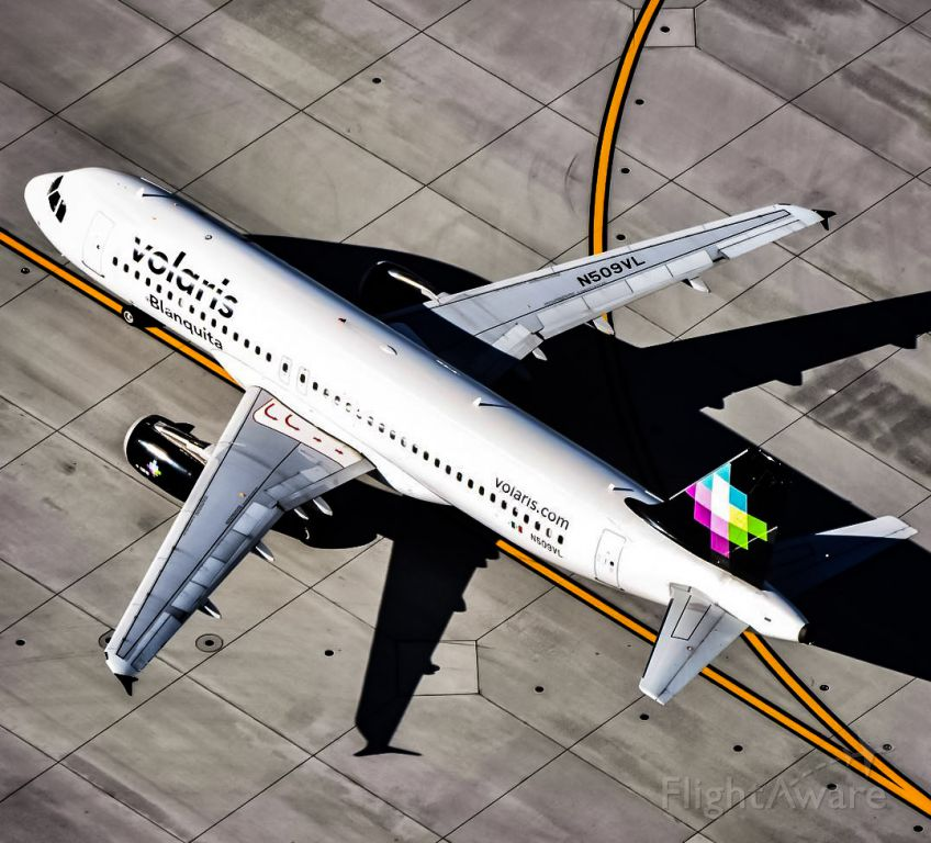 Airbus A320 (N509VL) - A great picture taken from the helicopter!