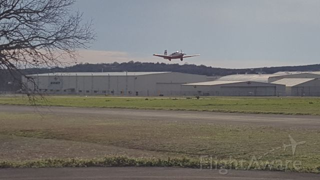 Mooney M-20 (N6830N) - A Mooney taking off in front of the Mooney plant in Kerrville Texas