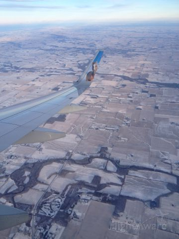 Airbus A320 (N307FR) - Descending into Indianapolis, Indiana in winter.br /Aboard Frontiers Champ the Bronco.