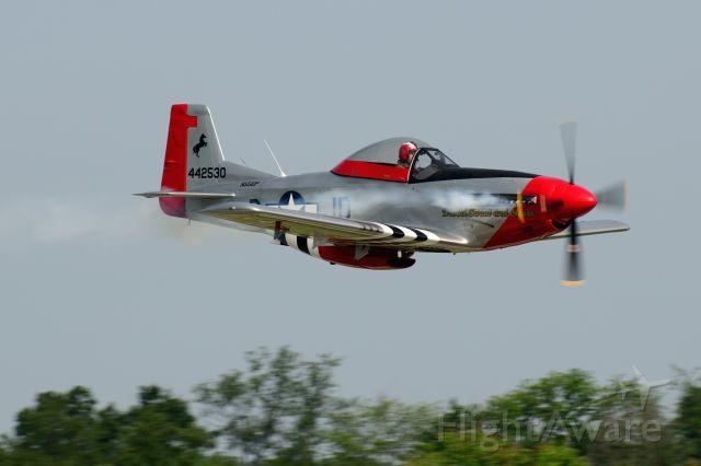 — — - Flyby down runway 8.  T-51 Mustang