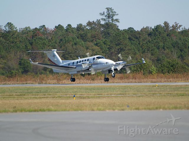 Beechcraft Super King Air 300 (N300MC) - Departing Goldsboro, NC. Photo by George Zimmerman.