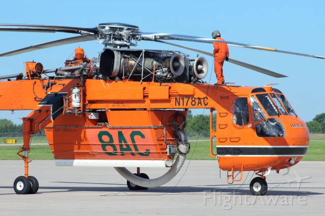 """Sikorsky CH-54 Tarhe (N178AC) - """"DO NOT START ROTORS YET""""....  Crew Chief from Erickson Aviation conducting pre-flight inspection."""