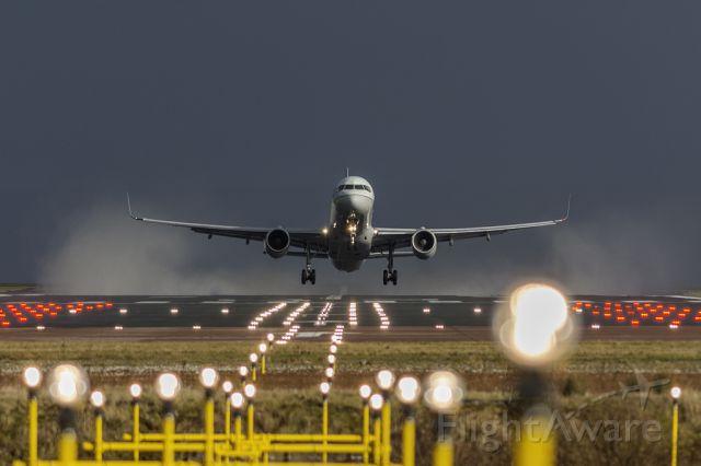 Boeing 757-200 (N34137) - Blasting off runway 23R, bound for Newark.