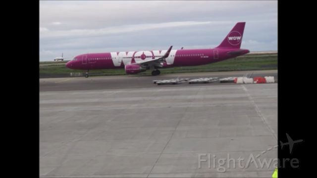 Airbus A321 — - *NOTE THIS PHOTO BELONGS TO MY GOOD FRIEND, ALL CREDITS GO TO HIM* A WOW Air Airbus A321 Taxiing While The IcelainderAir B757-200 Taxies To The Gate