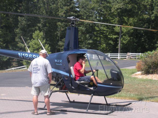 Robinson R-22 (N186SH) - Paul Salmon, CFII with Tim Brumitt in his driveway 2010