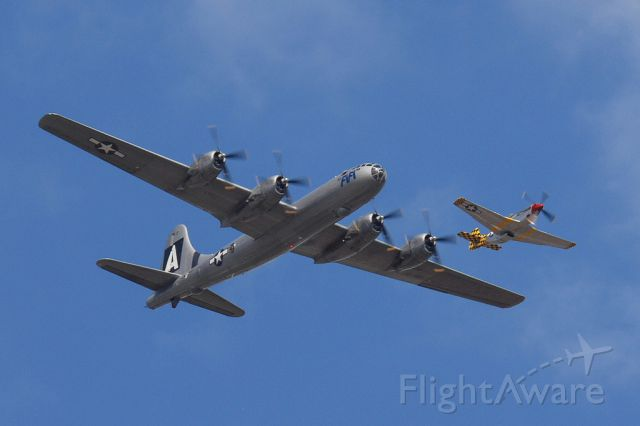 """Boeing B-29 Superfortress (N529B) - """"Fifi"""" in formation with P51 """"Boo-Man Choo"""" during the Wings Over Houston Airshow 2013."""