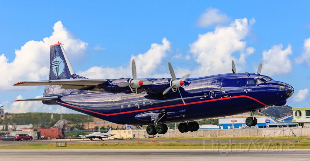 Antonov An-12 (UR-CNT) - Antonov 12 Ukraine Air Alliance call sign UKL5006 registration UR-CNT departing TNCM St Maarten on 20-12-2017 crossing the big pond with lots of pollution cant done!!!