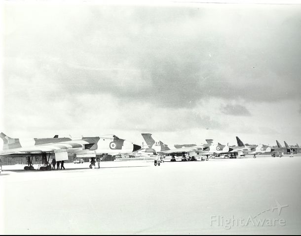 XM608 — - RAF Vulcans at Andersen AFB in transit to Singapore. Notice the night mission painted B-52Ds in the background.(1969)  R.F.