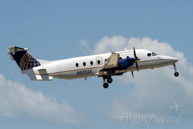 Beechcraft 1900 (N87555) - Airborne off rwy 8 operating flight GFT9194 to KTPA on 09-Apr-11.