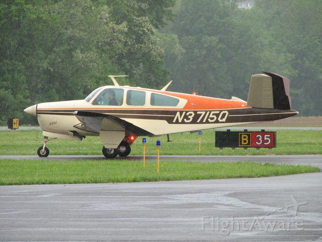 Beechcraft 35 Bonanza (N3715Q) - Running up after the pancake breakfast 2009