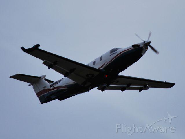Pilatus PC-12 (N695PG) - departing runway 28 at dusk at KSVH - 10/20/12