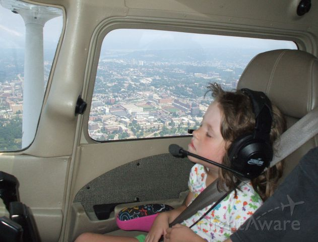 Cessna Skyhawk — - My daughters first airplane ride with me at the controls (5 yrs of age). She enjoyed the takeoff and touching a cloud at 4500 ft and seeing downtown Cincinnati, but fell asleep after 30 mins and missed the landing.
