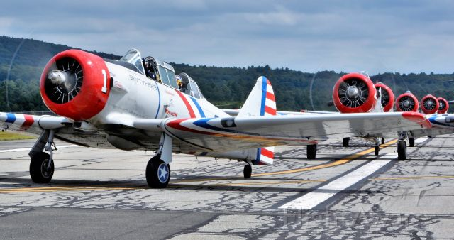 North American T-6 Texan (N65370) - Skytypers SNJ lineup post performance taxi in to ramp.