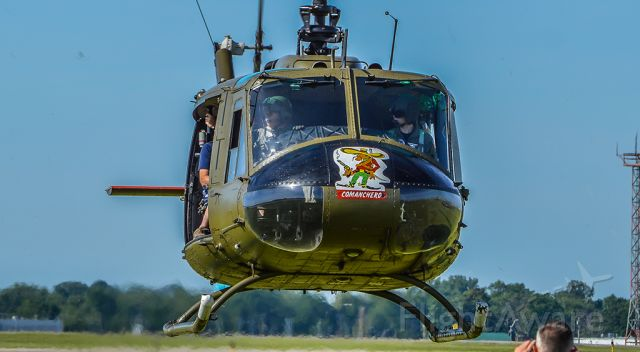 """Bell UH-1V Iroquois (N354HF) - LEGACY354 lifting off from the """"Legacy LZ"""" with the first official load of riders at the Dayton Air Show."""