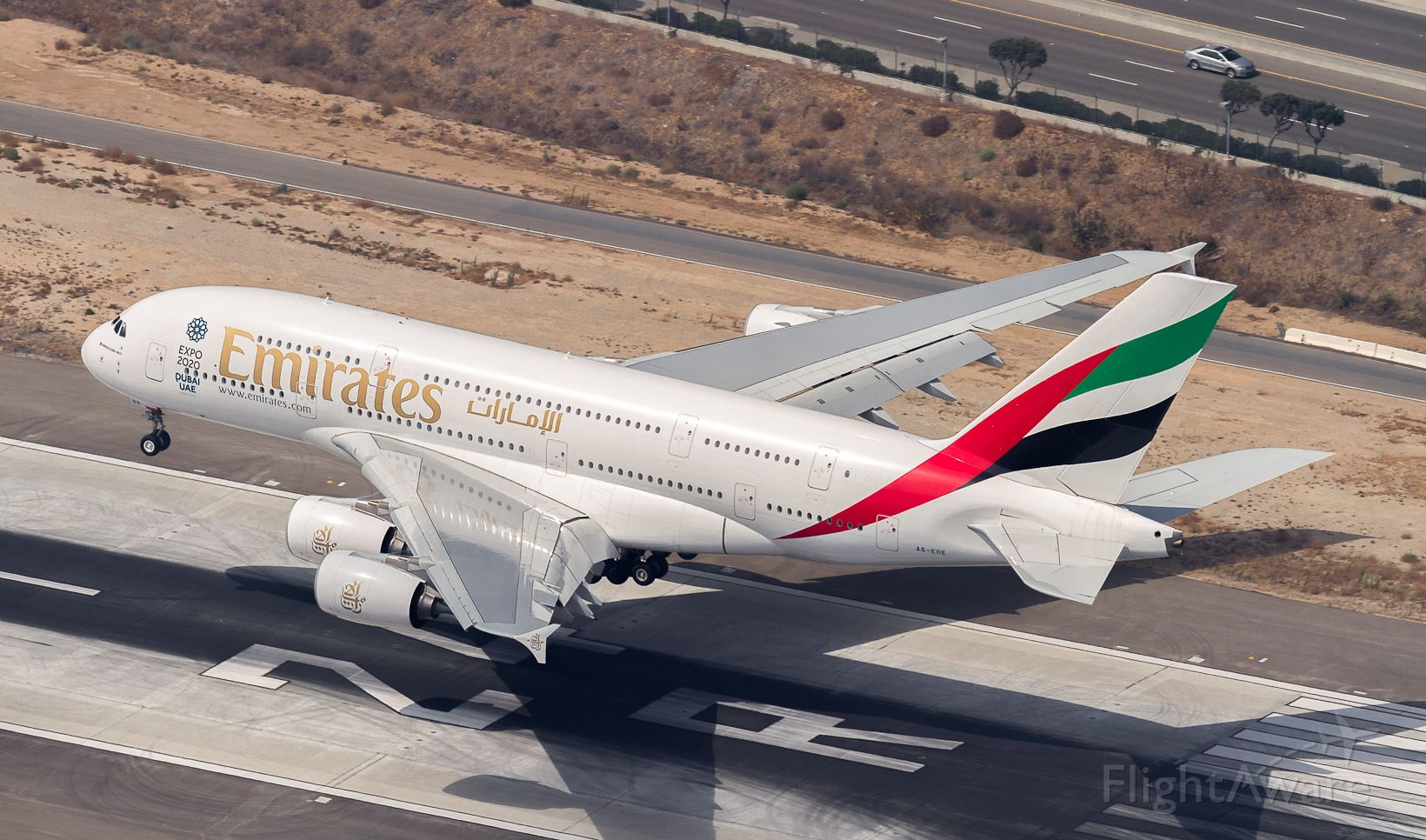 Airbus A380-800 (A6-EOE) - UAE215 about to touch down on runway 24R at LAX